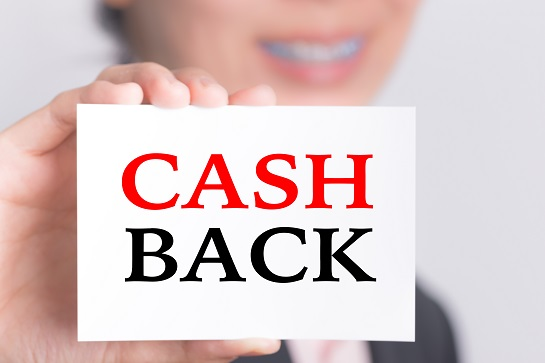 Cash Back, message on the card show by businesswoman