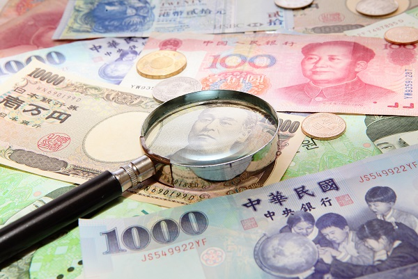 asian currency and magnifying glass (include Korean Won, Taiwan dollar, Chinese Money yuan , Hong Kong Dollar, japanese Yen)